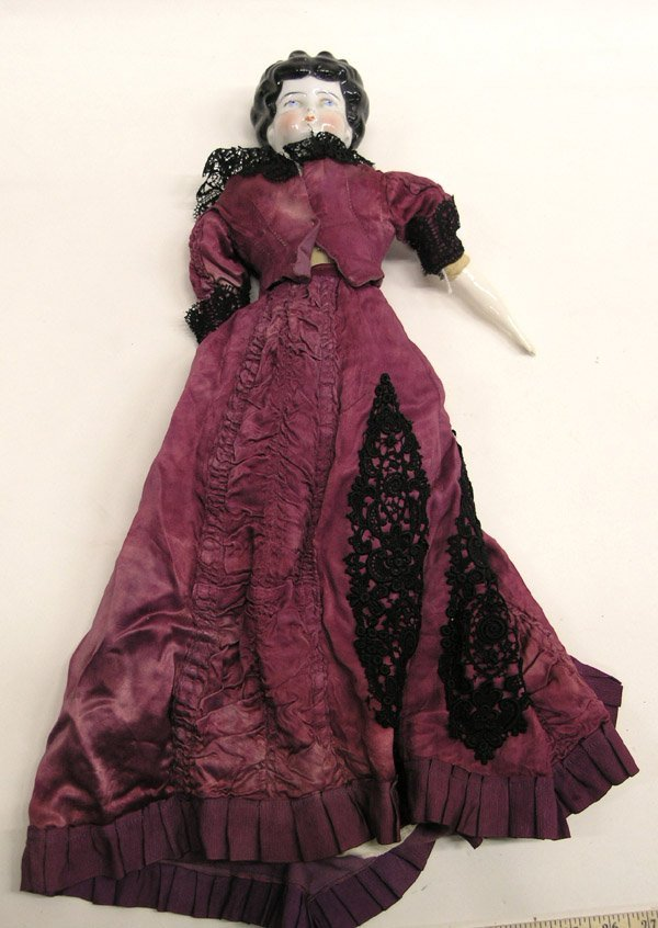 1803: Low brow china doll head