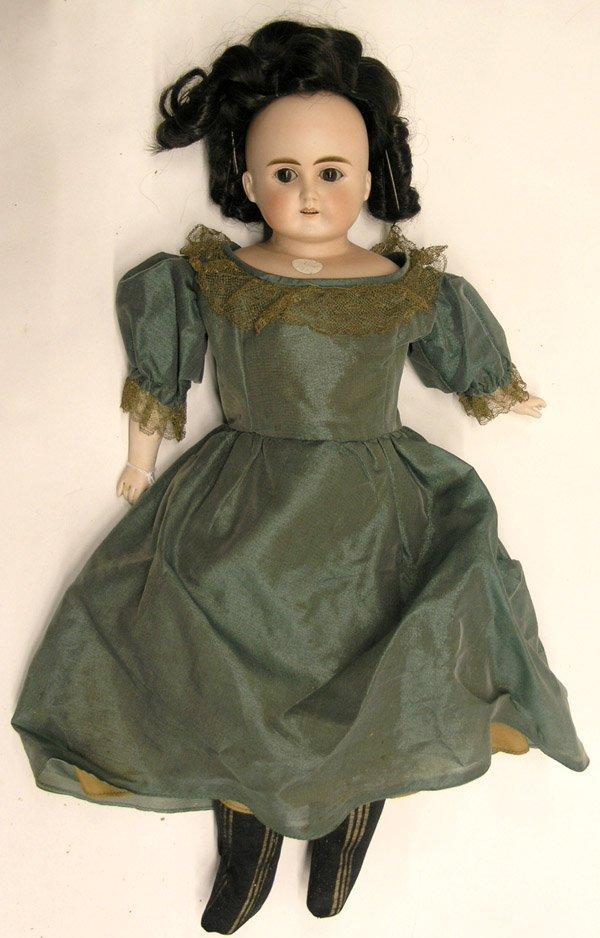 1805: Bisque head doll w/glass eyes