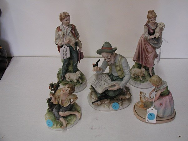 11: Handpainted porcelain figural groups