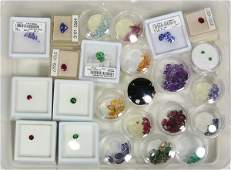 Collection of unmounted gemstones and wood storage box