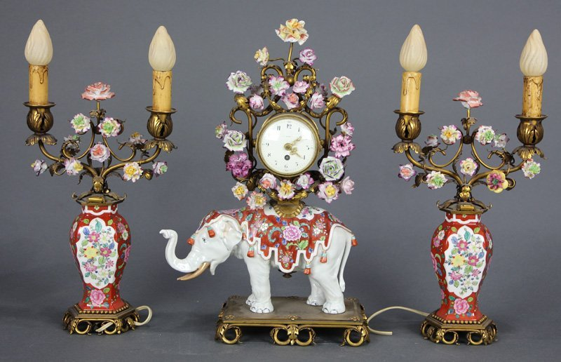 French porcelain clock with garniture executed in the