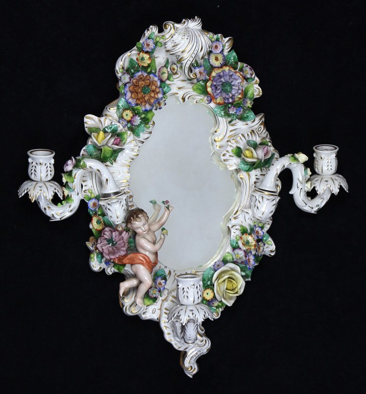 Continental polychrome decorated porcelain framed