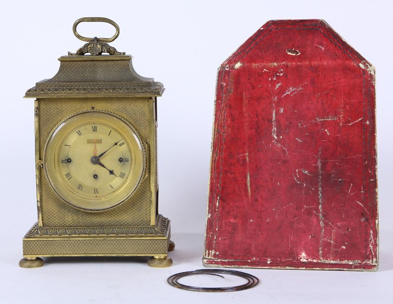 Grand Sonnerie clock having a red leather case, 30 hour