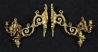 Pair of Louis XV style gilt bronze sconces, each having