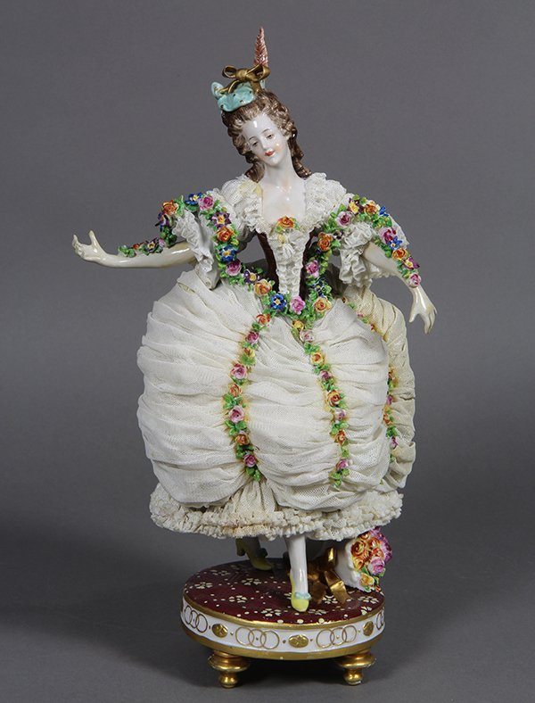 Continental crinoline polychrome decorated figurine,