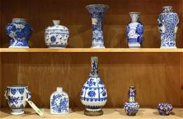 Two shelves of Chinese Blue and White Porcelains
