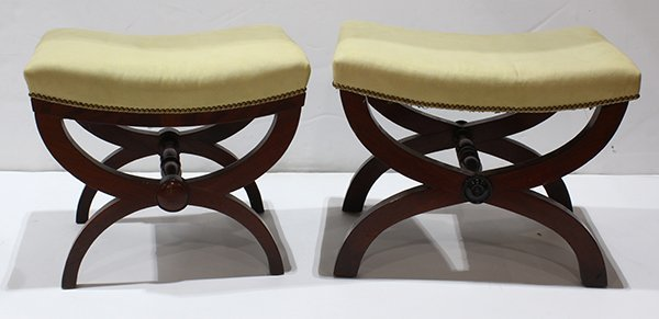 Pair of mahogany upholstered campaign style stools,
