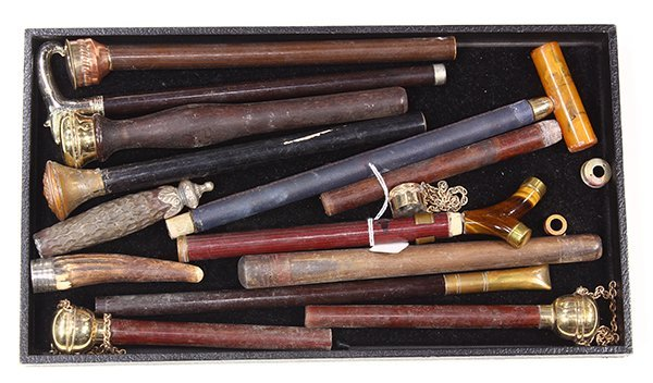 (lot of 15) Parasol, cane and riding crop handle group,