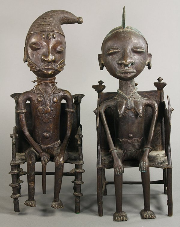 Pair of Yoruba metal figures, female and male, each