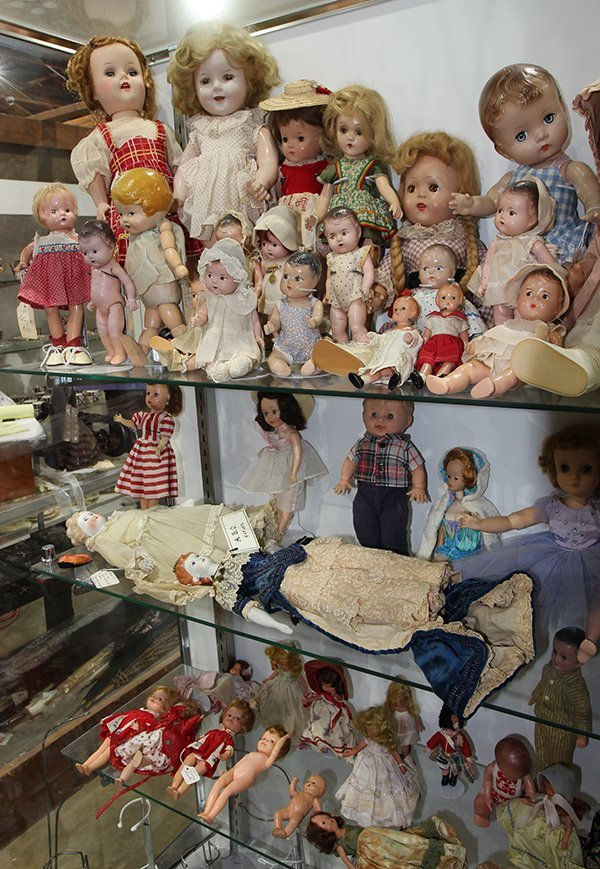 (Lot of 90+) Four shelf doll group, consisting of