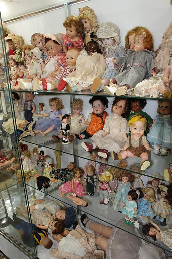 (Lot of 90+) Four shelf doll group, consisting of - 2