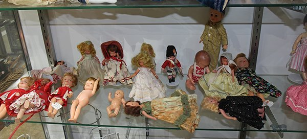 (Lot of 90+) Four shelf doll group, consisting of - 7