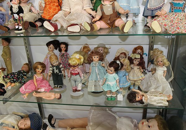 (Lot of 90+) Four shelf doll group, consisting of - 8