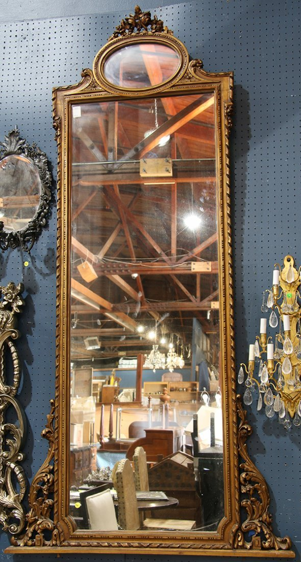 Neoclassical style gilt hall mirror, having scrolled