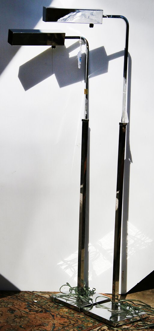 Pair of modern chrome floor lamps, each having a