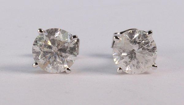 Pair of diamond and 14k white gold stud earrings