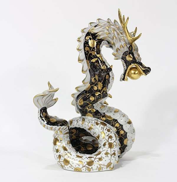 Herend porcelain painted and gilt figure of a dragon,