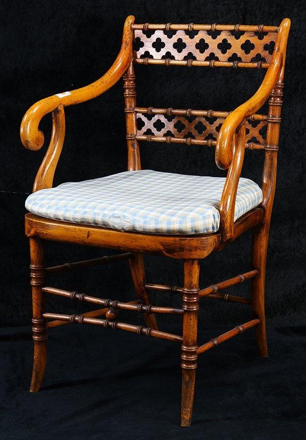 Regency style fruitwood armchair, having a pierced