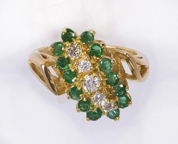 Emerald, diamond and 18k yellow gold ring
