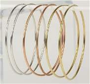 (Lot of 3) Pairs of gold hoop earrings