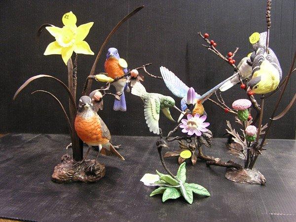 21: Handpainted porcelain birds on brass stands