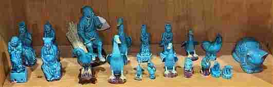 One Shelf of Chinese Turquoise Porcelain Figures