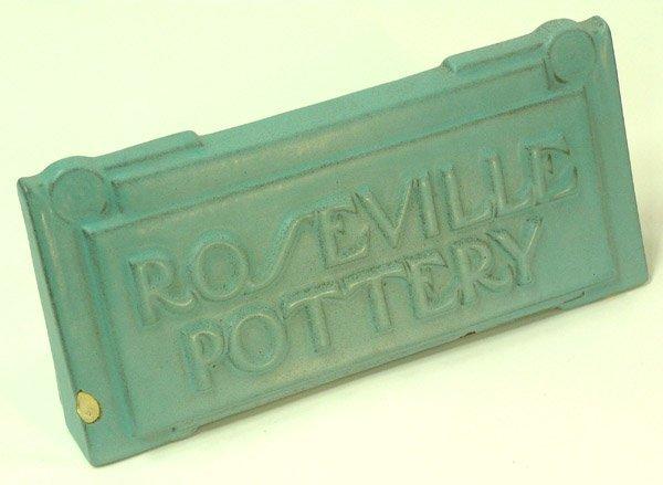 2021: Roseville pottery advertising sign