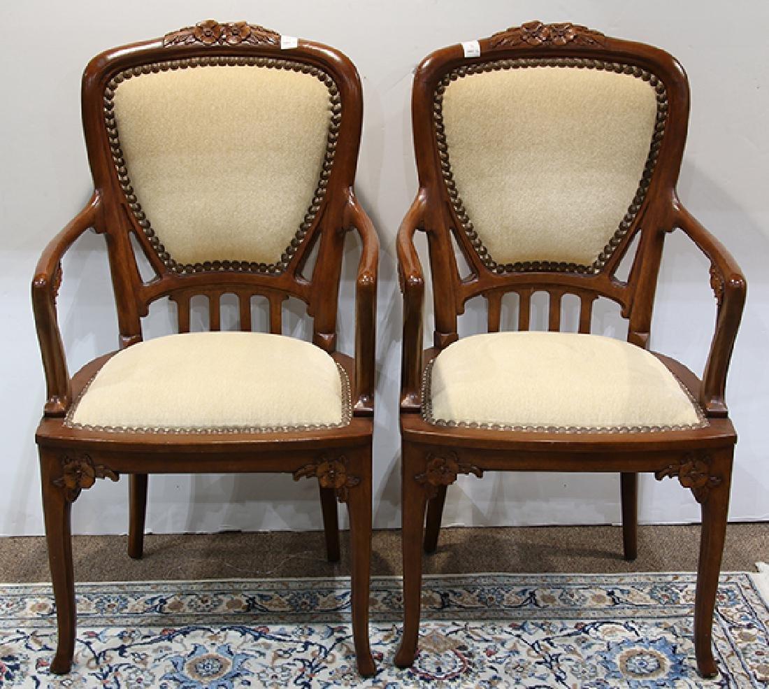 Pair of Art Nouveau style carved fauteuils