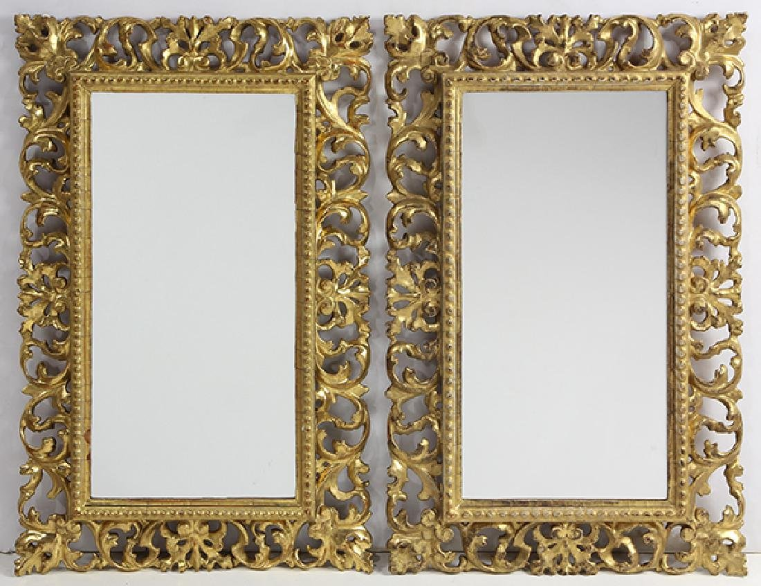 Pair of Continental giltwood carved mirrors, each