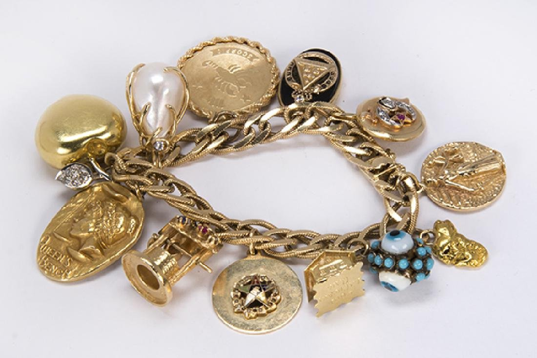 Multi-stone and yellow gold charm bracelet