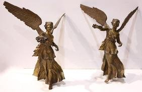 Pair of patinated and gilt bronze figural sculptures