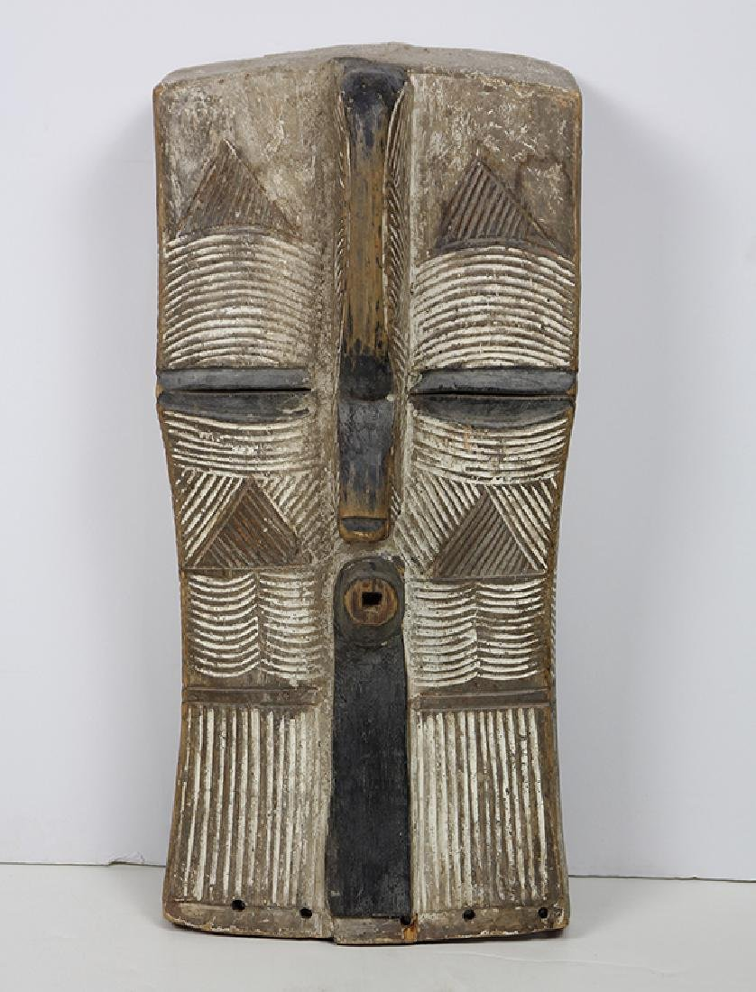 Large abstract African ceremonial mask carved,