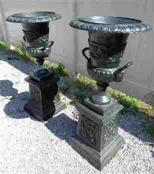Pair of Cast Iron Urns With Handles on Pedestal Bases