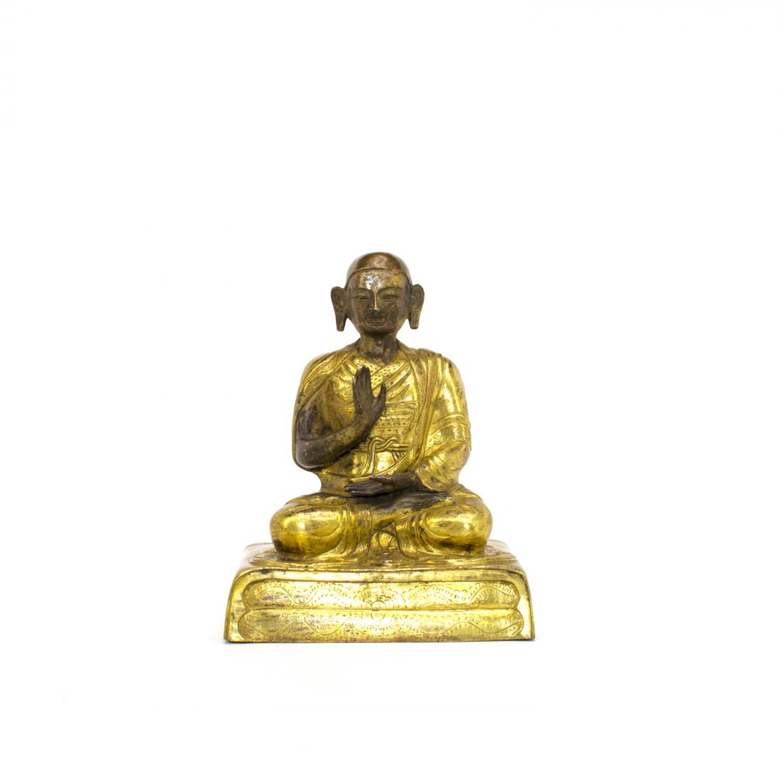 A CHINESE GILTED BRONZE FIGURE OF SEATED BUDDHA