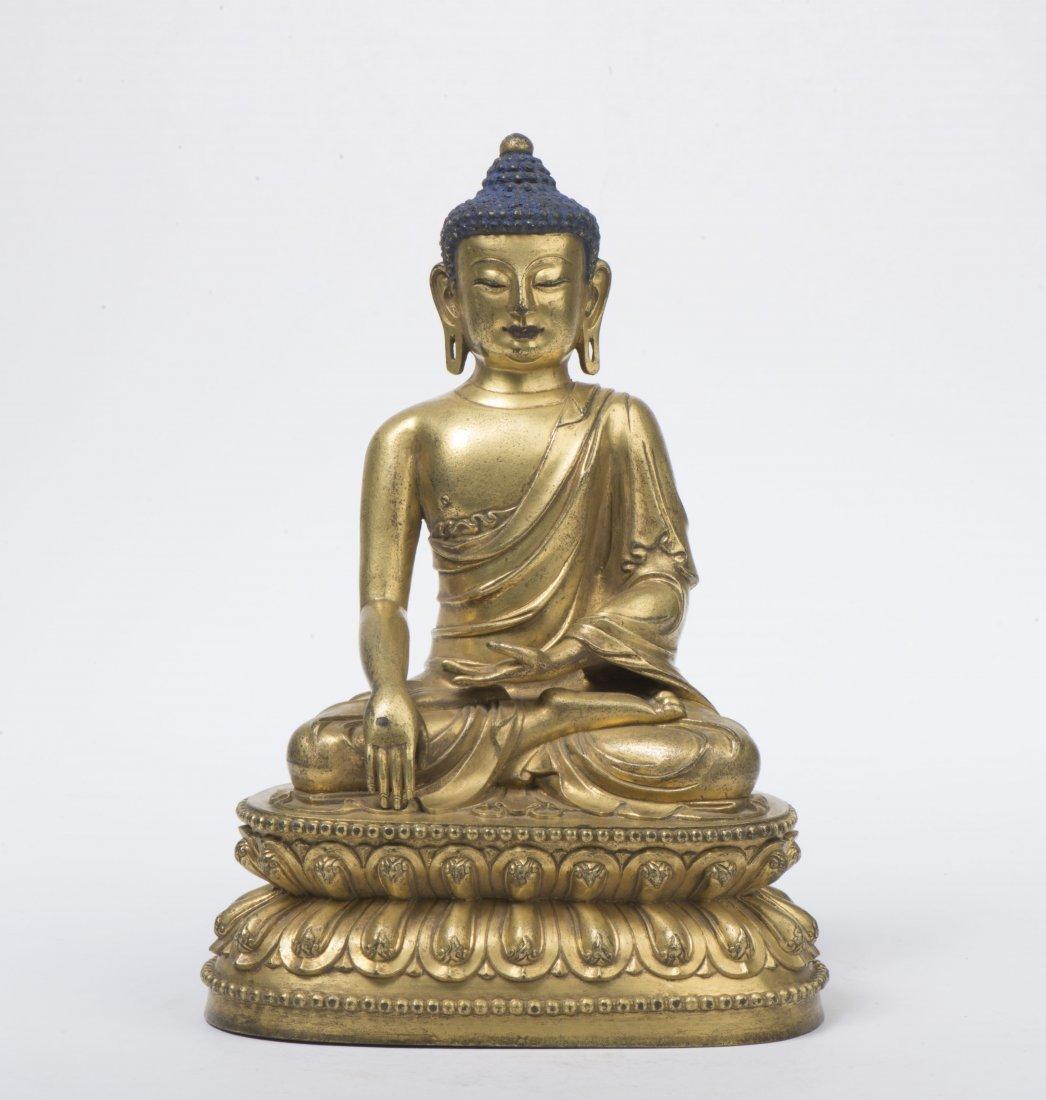 A GILT-BRONZE FIGURE OF SAKYAMUNI