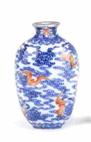 A CHINESE BLUE AND WHITE IRON-RED SNUFF BOTTLE