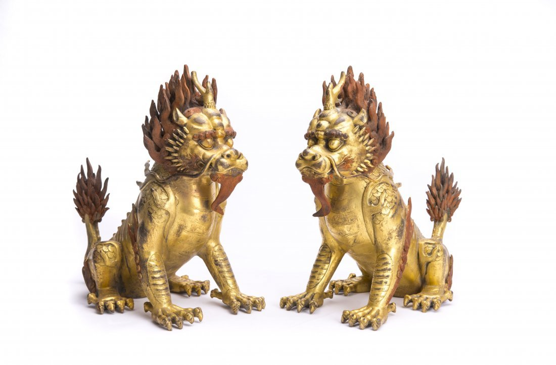 A PAIR OF GILT-BRONZE QILIN FIGURES