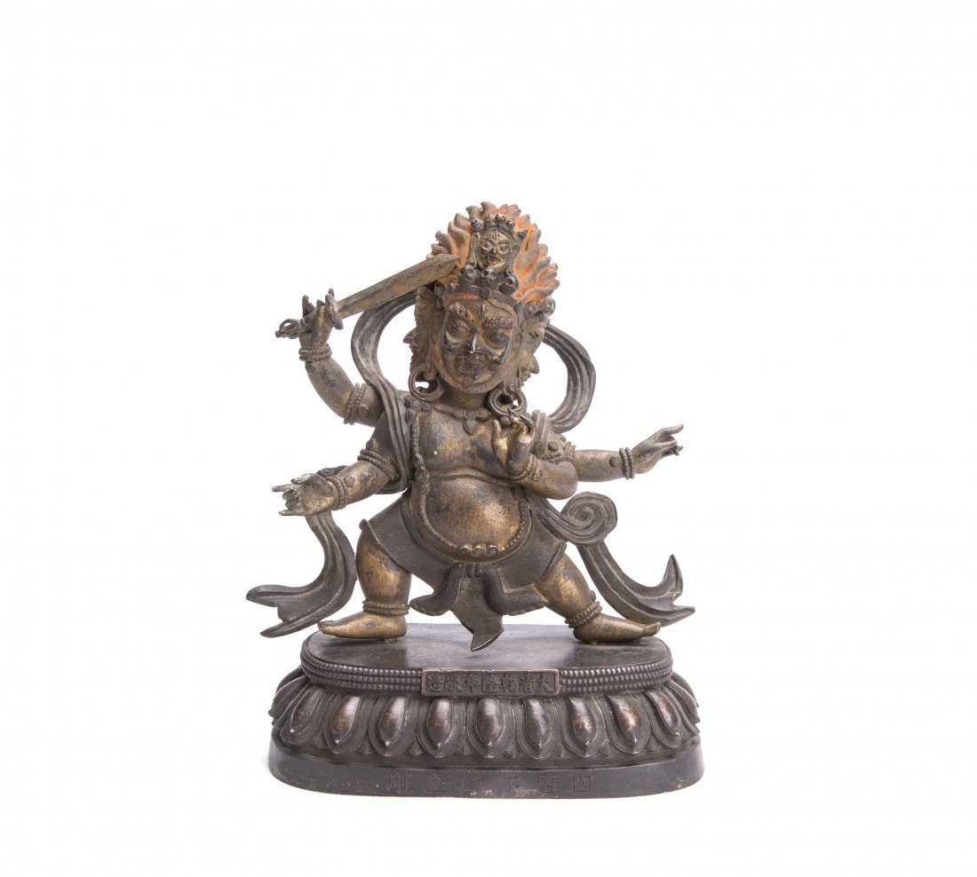 A GILT-BRONZE FIGURE OF ACALA VAJRA