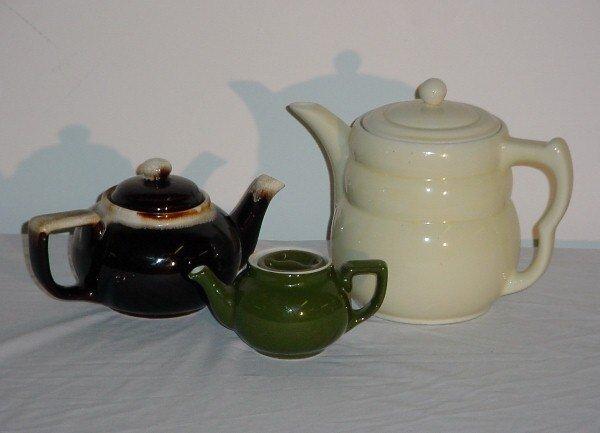 12: Three vintage teapots.