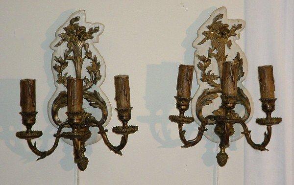 384: Pair 19th C Louis XV style bronze three-light wall