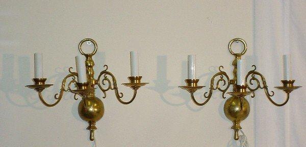 385: Pair Dutch bronze three-light wall sconces. Scroll