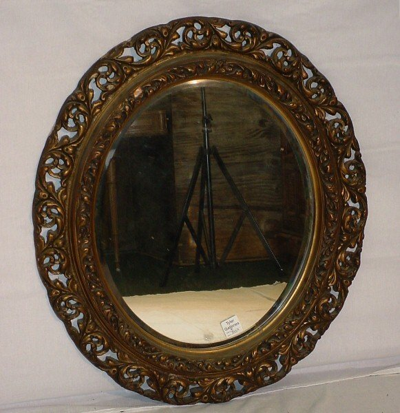 392: 19th C Continental giltwood carved mirror. The ova