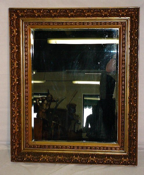 393: 19th C Continental giltwood carved mirror. Rectang