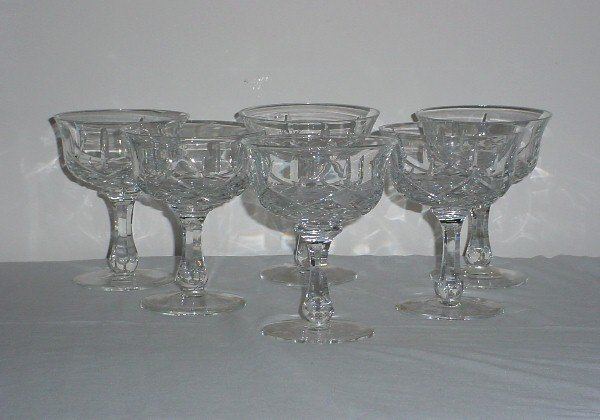 2: Set of six colorless crystal champagne glasses.