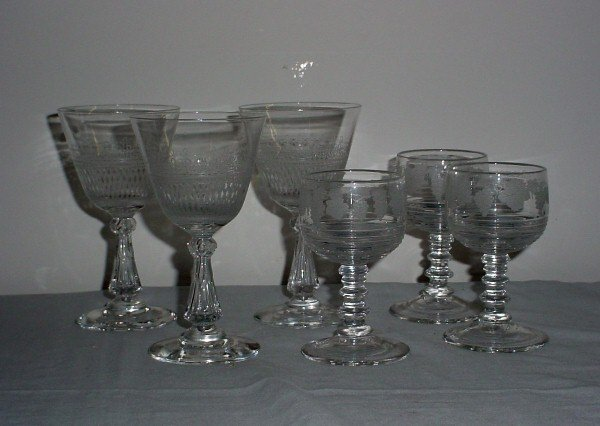 3: Six colorless etched crystal glasses.