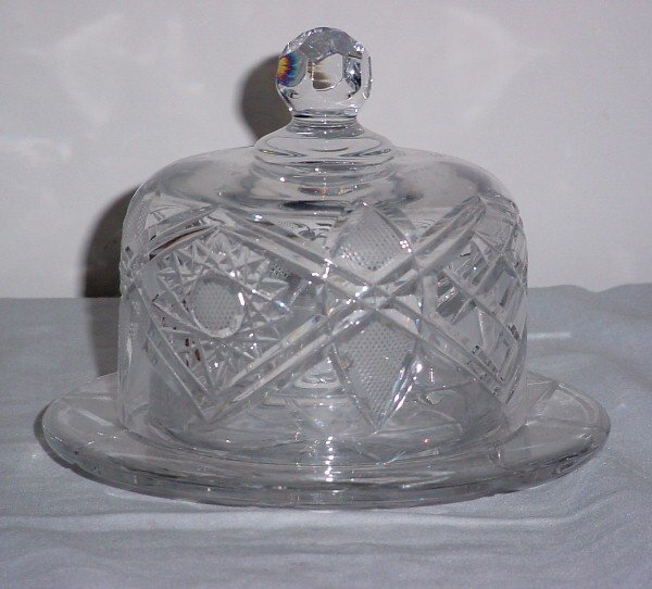 11: Cut glass cheese dish and dome.