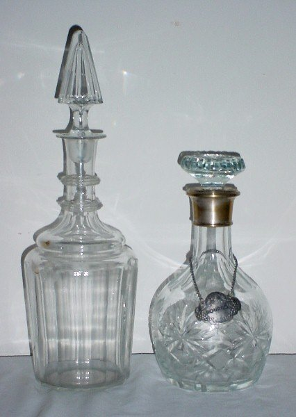 13: Two colorless crystal decanters and stoppers