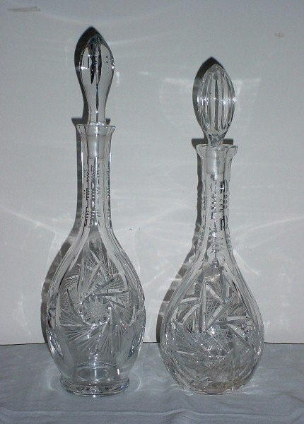 14: Two colorless cut crystal decanters and stoppers.