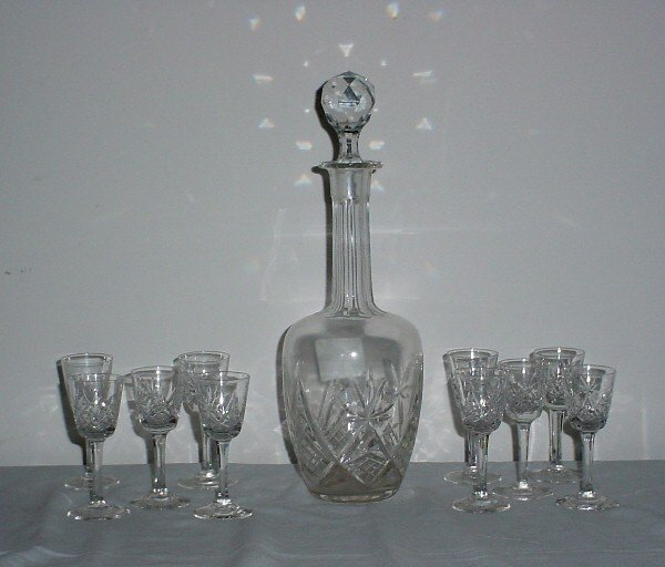 15: Colorless cut crystal decanter and stopper with ten