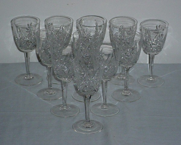 17: Eleven colorless cut crystal wine glasses